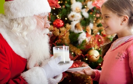 young girl sharing snacks with Santa